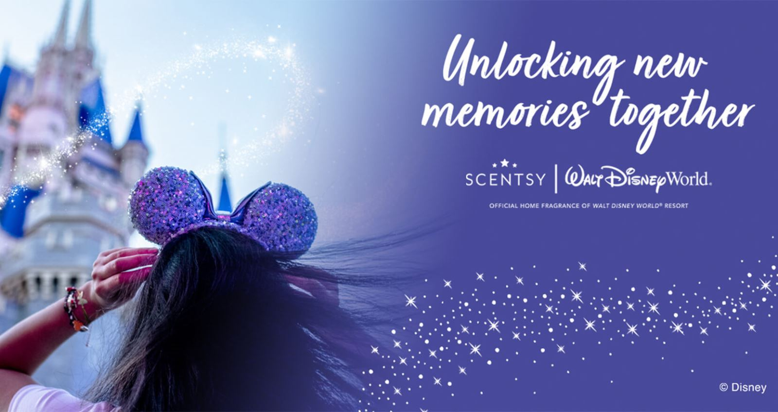 A girl with a sequined Mickey Mouse ear headband stands in front of the iconic Cinderella Castle in Walt Disney World Resort against a clear blue sky and a swirl of dazzling pixie dust. Scentsy is becoming the Official Home Fragrance of Walt Disney World Resort, 'unlocking new memories together.'