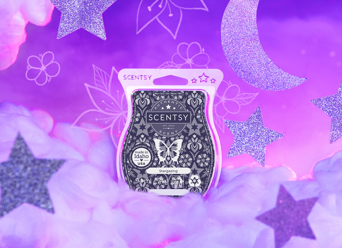 The July Warmer of the Month: Above the Clouds sitting next to the July Scent of the Month: Stargazing Scentsy Bar. The warmer and Scentsy Bar are sitting on a table in a child's room